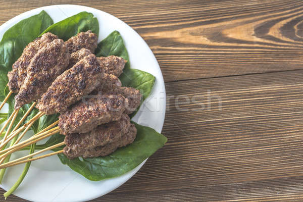 Beef cabobs on the fresh spinach leaves Stock photo © Alex9500