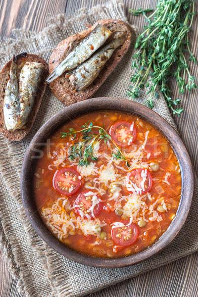 Porción verde lenteja sopa de tomate fondo mesa Foto stock © Alex9500