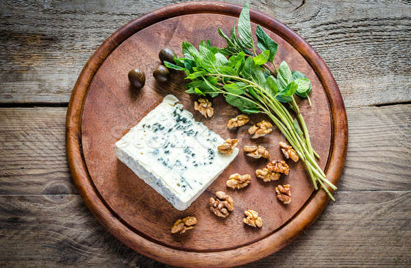 Blue cheese with walnuts and fresh mint Stock photo © Alex9500
