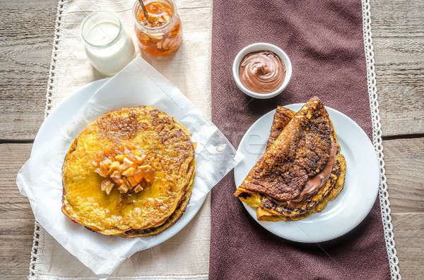 Pumpkin crepes with fruit confiture and chocolate cream Stock photo © Alex9500