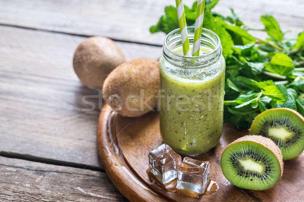 Glass jar of kiwi smoothie Stock photo © Alex9500