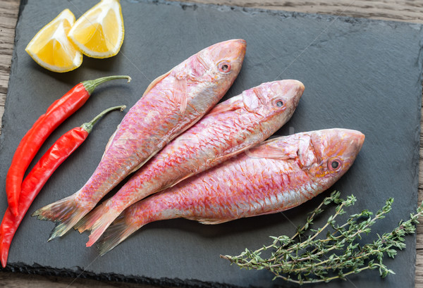 Raw red mullet with ingredients Stock photo © Alex9500
