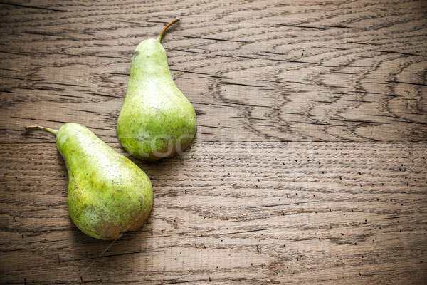 Halves of green pear on the wooden background Stock photo © Alex9500