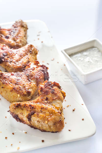 Fried chicken wings on the white plate Stock photo © Alex9500