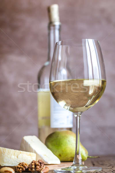 Glass of white wine with cheese and nuts Stock photo © Alex9500