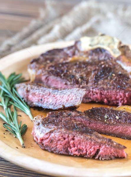 Beef steak with fresh rosemary Stock photo © Alex9500