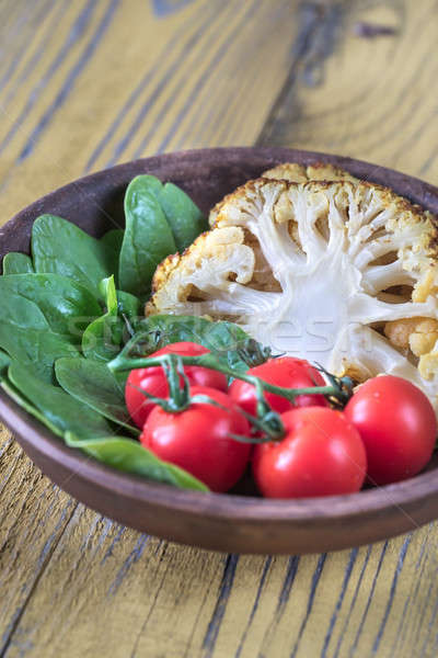 Baked cauliflower with cherry tomatoes and fresh spinach Stock photo © Alex9500