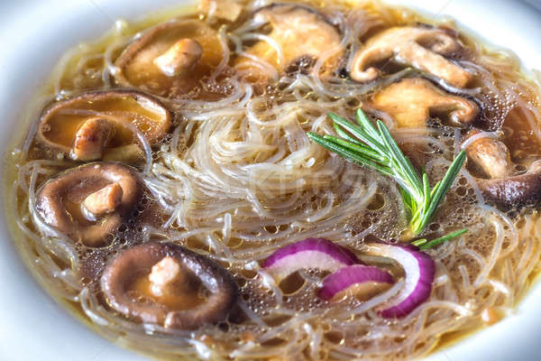 Portion of shiitake ginger soup on the wooden table Stock photo © Alex9500