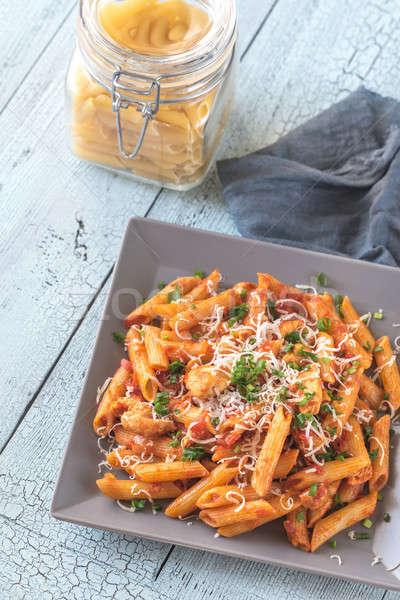 Portion of cheesy chicken pasta Stock photo © Alex9500