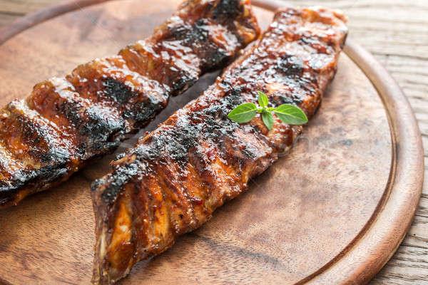 Grelhado carne de porco costelas cozinha vermelho Foto stock © Alex9500