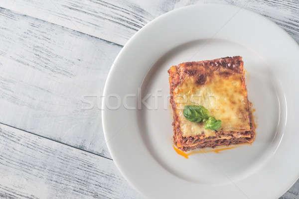 Porción lasaña mesa de madera hoja fondo restaurante Foto stock © Alex9500