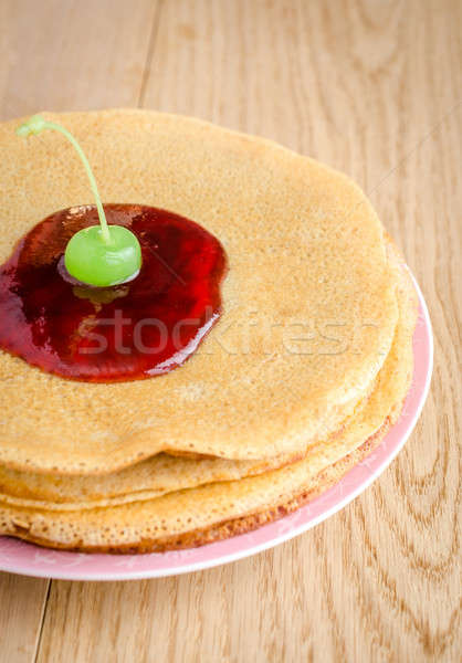 Crepes under cherry topping Stock photo © Alex9500