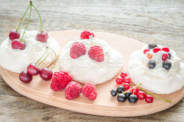 Stock photo: Meringue cakes with fresh berries