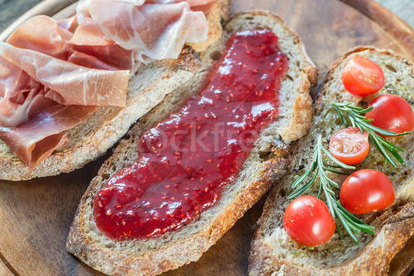 Bruschetta with different toppings Stock photo © Alex9500