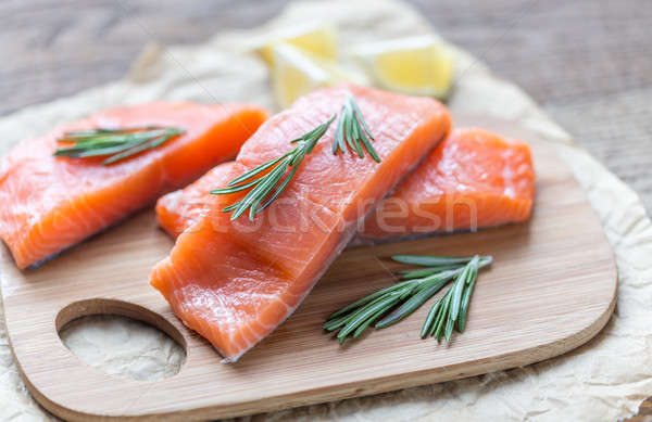 Raw salmon on the wooden board Stock photo © Alex9500