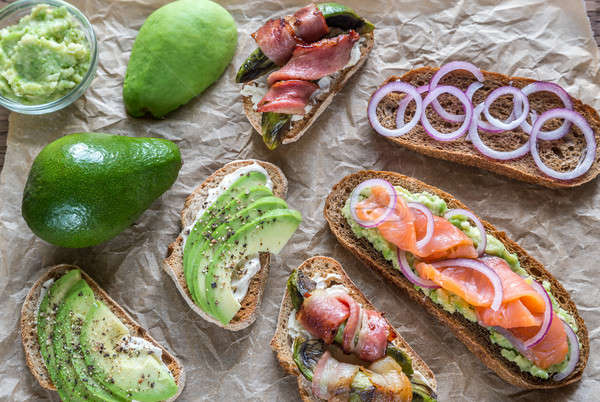 Toasts with avocado and different toppings Stock photo © Alex9500