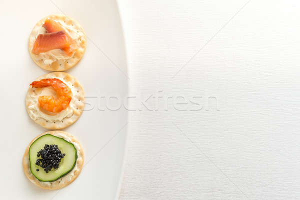 Canape with seafood on the plate Stock photo © Alex9500
