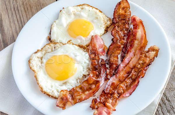 ストックフォト: フライド · 卵 · ベーコン · 木製のテーブル · 食品 · 白