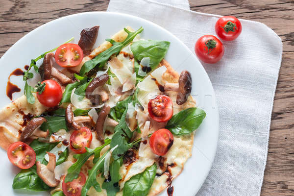 Crepes with cherry tomatoes, cheese, mushrooms and arugula Stock photo © Alex9500