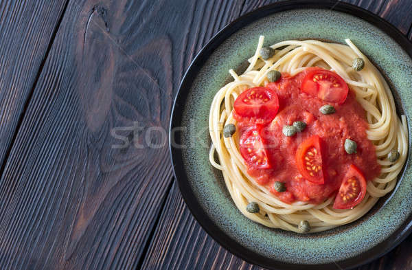 Pasta with tomato sauce and capers on the plate Stock photo © Alex9500