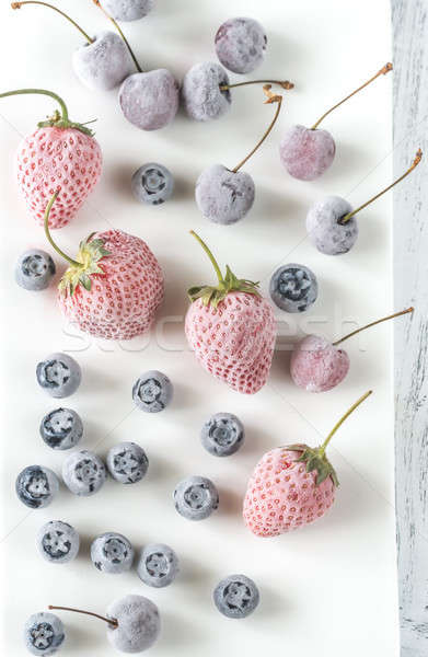 Assortment of frozen berries on the white plate Stock photo © Alex9500