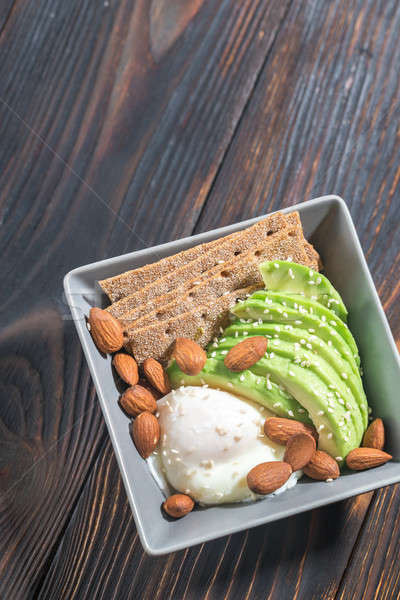 Poached egg with avocado and almonds Stock photo © Alex9500