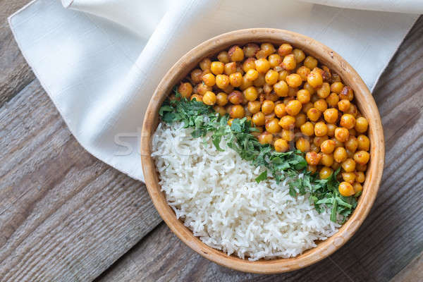 Bowl of chickpea curry with white rice and fresh cilantro Stock photo © Alex9500