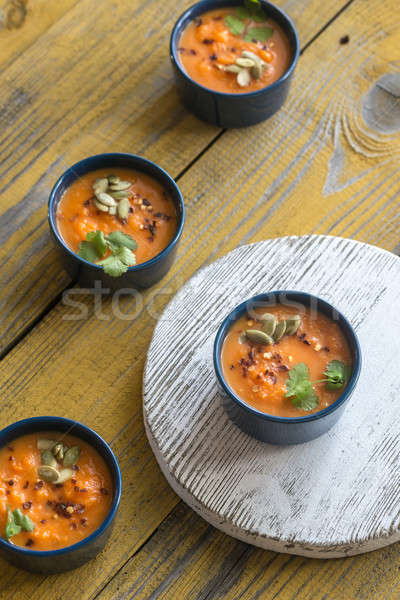 Bowls of pumpkin cream soup Stock photo © Alex9500