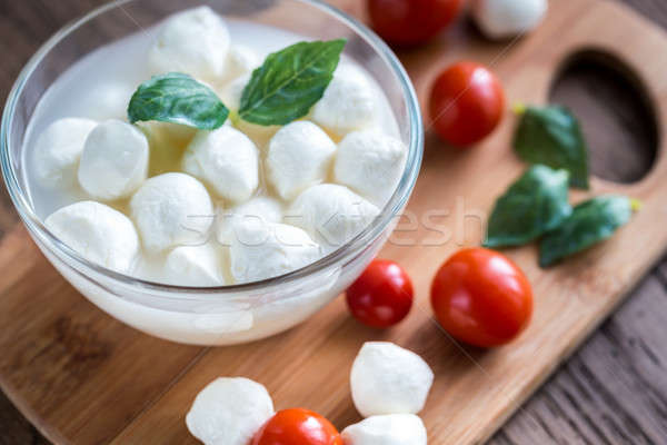Bowl of Bocconcini mozzarella with fresh cherry tomatoes Stock photo © Alex9500