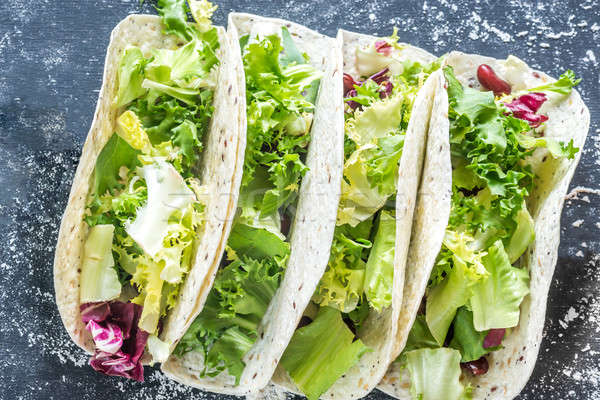 Four vegetarian tacos on a black background Stock photo © Alex9500