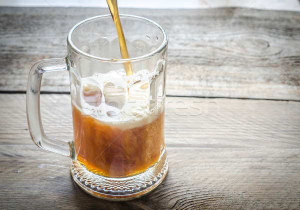 Beer pouring into mug Stock photo © Alex9500