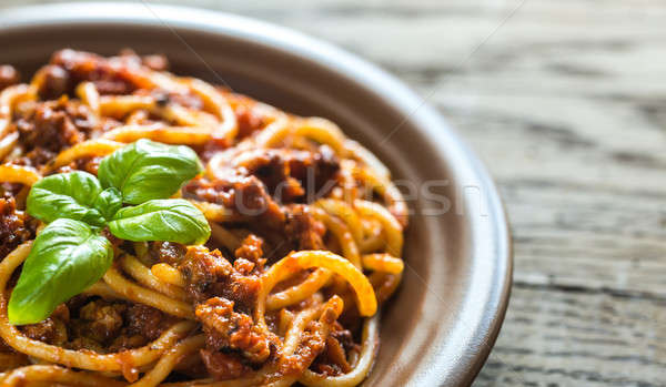 Spaghetti with bolognese sauce on the wooden background Stock photo © Alex9500