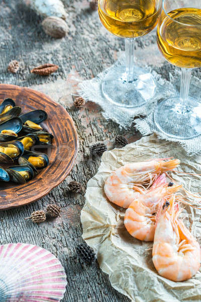 Seafood with two glasses of white wine on the wooden table Stock photo © Alex9500