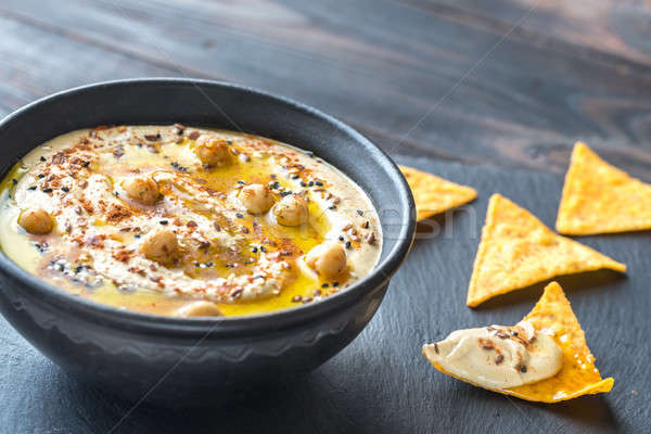 Bowl of hummus with tortilla chips Stock photo © Alex9500