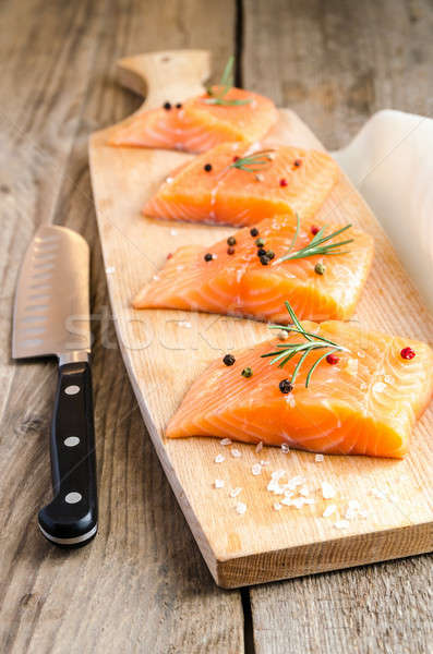 Raw salmon steaks on the wooden board Stock photo © Alex9500