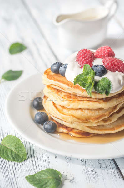 Pancakes with whipped cream and fresh berries Stock photo © Alex9500