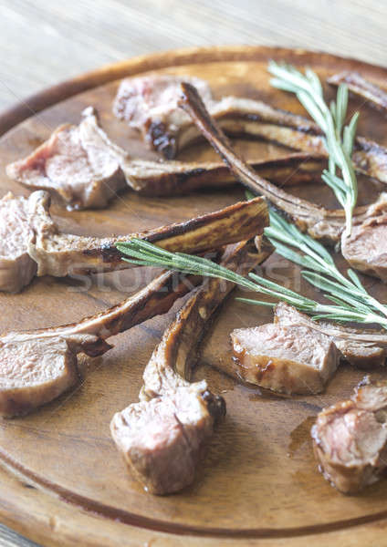 Grilled lamb rib chops on the wooden board Stock photo © Alex9500