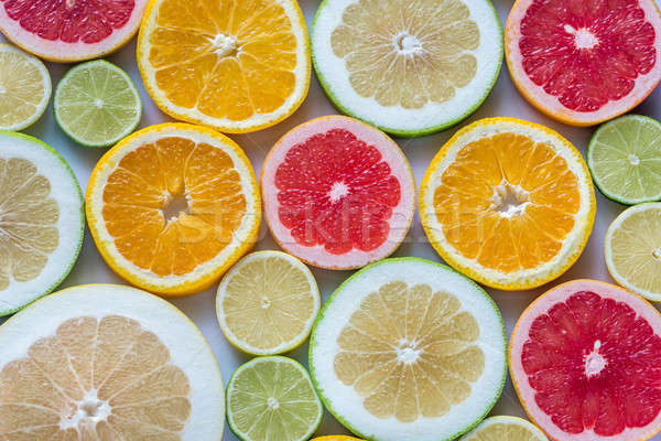 Slices of citrus fruits: top view Stock photo © Alex9500