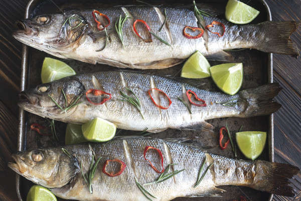 Baked sea bass with lime and chilli pepper Stock photo © Alex9500