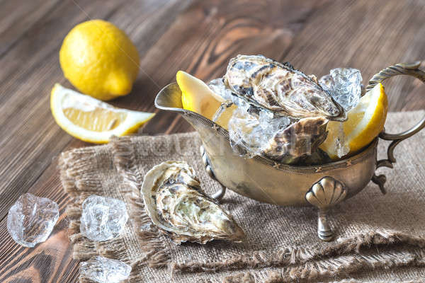 Raw oysters in the gravy boat Stock photo © Alex9500