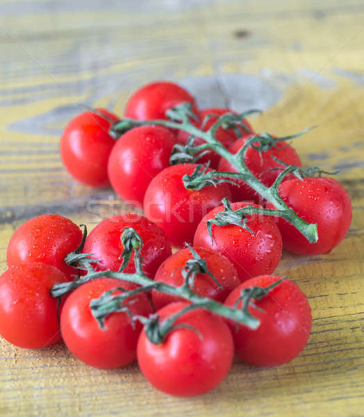 Bunch of fresh cherry tomatoes on the wooden table Stock photo © Alex9500