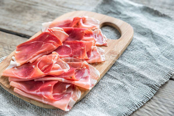 Slices of jamon on the wooden board Stock photo © Alex9500