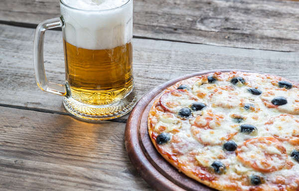 Pişmiş pizza cam bira arka plan Stok fotoğraf © Alex9500
