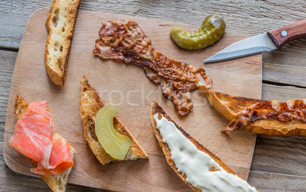 Toasts with different toppings on the wooden board Stock photo © Alex9500