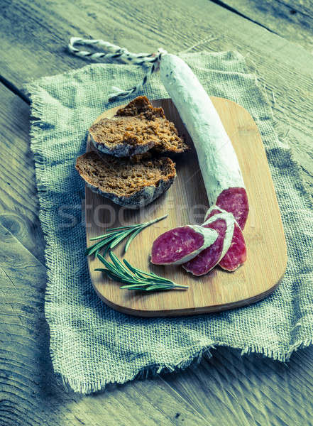 Slices of spanish salami on the sackcloth Stock photo © Alex9500