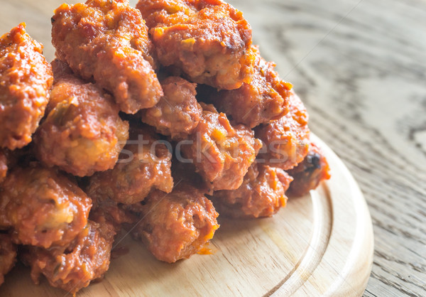 Fried chicken wings on the wooden board Stock photo © Alex9500