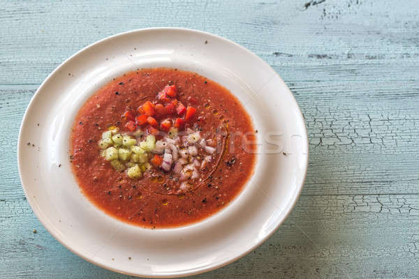 Portion of gazpacho on the wooden table Stock photo © Alex9500