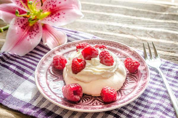 Stock photo: Meringue with fresh raspberries