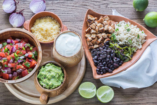 Chicken burrito bowl with the ingredients Stock photo © Alex9500