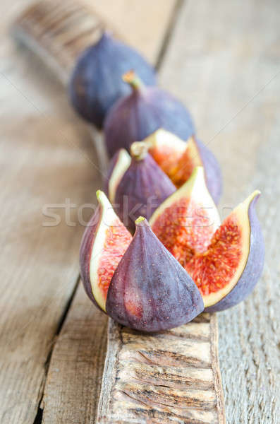 Ripe figs : cross section and whole fruits Stock photo © Alex9500